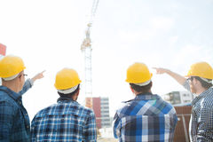 Group of builders in hardhats at construction site Royalty Free Stock Photos