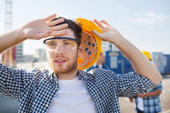 Group of builders in hardhats outdoors Stock Photos