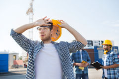 Group of builders in hardhats outdoors Royalty Free Stock Images