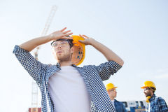 Group of builders in hardhats outdoors Royalty Free Stock Photo