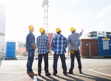 Group of builders in hardhats outdoors Royalty Free Stock Photos