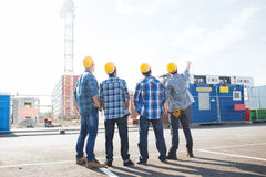 Group of builders in hardhats outdoors Royalty Free Stock Photography