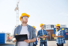 Group of builders in hardhats outdoors Stock Image