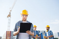 Group of builders in hardhats outdoors Stock Photography