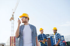 Group of builders in hardhats with radio Stock Photos