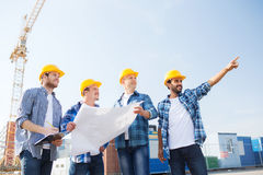 Group of builders with tablet pc and blueprint Royalty Free Stock Photography
