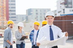 Group of builders with tablet pc and blueprint Stock Image