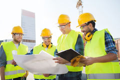 Group of builders with tablet pc and blueprint Royalty Free Stock Photo