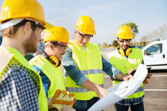 Group of builders with tablet pc and blueprint Stock Photography