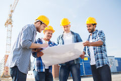 Group of builders with tablet pc and blueprint Royalty Free Stock Images