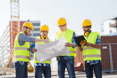 Group of builders with tablet pc and blueprint Royalty Free Stock Photos