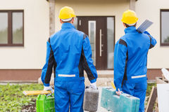 Group of builders with toolboxes. Business, building, teamwork and people concept - group of builders in hardhats with toolboxes outdoors royalty free stock photography