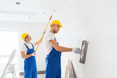 Group of builders with tools indoors Stock Photos
