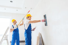Group of builders with tools indoors Royalty Free Stock Photo