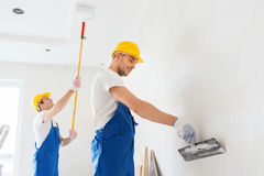 Group of builders with tools indoors Royalty Free Stock Images
