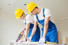 Group of builders with tools indoors Royalty Free Stock Photos