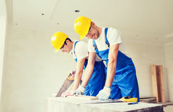 Group of builders with tools indoors Royalty Free Stock Image