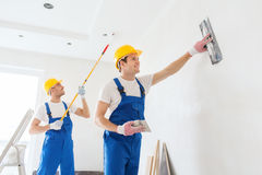 Group of builders with tools indoors Stock Images