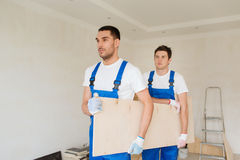 Group of builders with wooden boards Stock Image