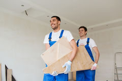 Group of builders with wooden boards Royalty Free Stock Photography