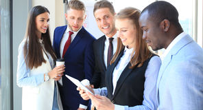 Group of buisness people. Working on tablet Royalty Free Stock Image