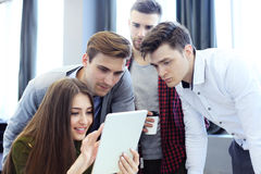 Group of buisness people working on tablet. Stock Photo
