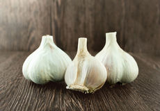 Group bulb Head of garlic on wood background with shadow Royalty Free Stock Photography
