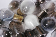 Group of burned out light bulbs. Stock Photos