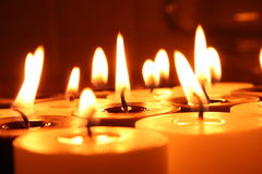 Group of burning black and white candles Royalty Free Stock Photos