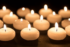Group of burning candles at black background Stock Photo