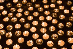 Group of burning candles at a black background Royalty Free Stock Photography