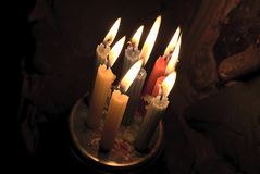 Group of burning candles near to stones. Picture of a group of burning candles near to stones royalty free stock photo