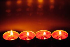 Group of burning red tealight candles Royalty Free Stock Photos