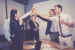 Group business asian people team with success gesture giving hi five in the meeting, agreement royalty free stock photography