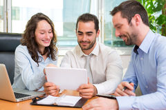 Group of business associates working together at the office Stock Photography