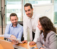 Group of business associates working together at the office Royalty Free Stock Photo