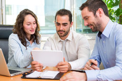 Group of business associates working together at the office stock photos
