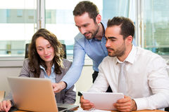 Group of business associates working together at the office Stock Image