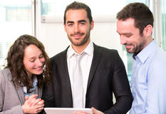 Group of business associates working together at the office Royalty Free Stock Photography