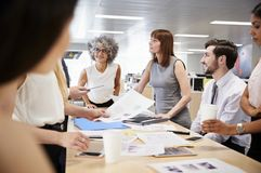 Group of business colleagues brainstorm in open plan office royalty free stock photos