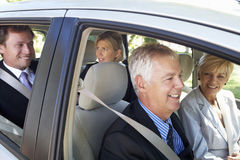 Group Of Business Colleagues Car Pooling Journey Into Work Stock Images