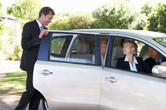 Group Of Business Colleagues Car Pooling Journey Into Work Royalty Free Stock Photography