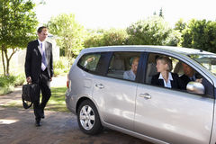 Group Of Business Colleagues Car Pooling Journey Into Work Royalty Free Stock Image