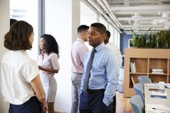 Group Of Business Colleagues Chatting In Office After Meeting royalty free stock image