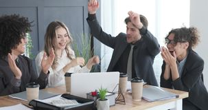 Businessman team celebrating online success at office. Group of business colleagues cheering and celebrating online success at office stock footage