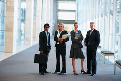 Group of business colleagues at a hallway Stock Images