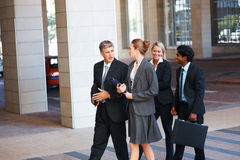 Group of business colleagues walking Stock Photo