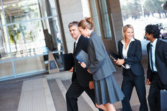 Group of business colleagues walking together Stock Image