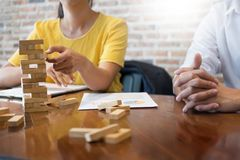 Group of business creative people building tower by wooden block. S, doing a plan for brainstrom business strategy, risk, future, teamwork concept Stock Image