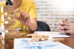 Group of business creative people building tower by wooden block. S, doing a plan for brainstrom business strategy, risk, future, teamwork concept Royalty Free Stock Photos